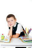 Little boy with a school backpack and books Stock Image