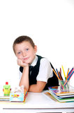 Little boy with a school backpack and books Royalty Free Stock Image