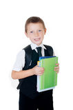 Little boy with a school backpack and books Royalty Free Stock Photo