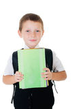 Little boy with a school backpack and books Stock Photo