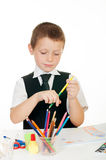 Little boy with a school backpack and books Stock Photography