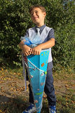 Little boy with a school bag Stock Images
