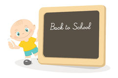 Little boy and school blackboard Stock Images