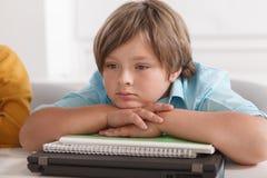 Little boy at school class
