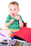 Little boy with school supplies Stock Photos