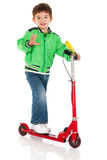Little boy on the scooter Stock Photos