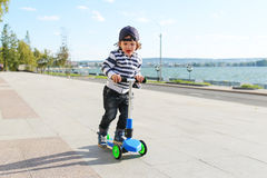 Little boy with scooter Royalty Free Stock Photography