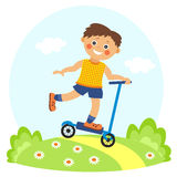 Little boy on scooter. In summer Royalty Free Stock Photography