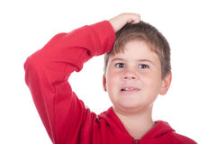 Little boy scratches a head. On a white background Royalty Free Stock Photos