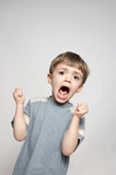 Little boy screaming. Portrait of an angry 3 year old boy screaming with fists clenched Royalty Free Stock Photos