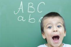 Little Boy Screaming. Very Happy at Blackboard Stock Photos