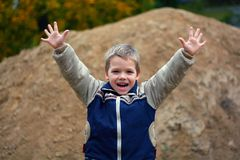 Little boy screaming. And wave with his arms Royalty Free Stock Images