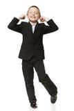 Little boy screaming of joy. 6 years old boy screaming of joy over white background Stock Photo