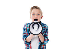 Little boy screaming in megaphone and looking at camera Royalty Free Stock Photos