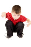 The little boy screaming and writhe a face. Isolated on white background Stock Images