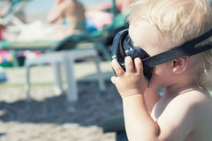 Little boy in scuba mask Stock Images