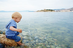 Little boy in the sea Stock Images