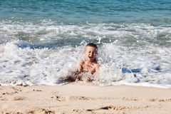Little boy on sea beach Stock Photo