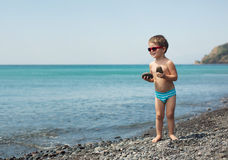 Little boy at sea beach Stock Photography