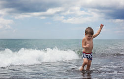 Little boy at sea beach Stock Images