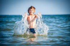 Little boy in the sea. Happy little boy in the sea Stock Photo