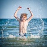 Little boy in the sea. Happy little boy in the sea Royalty Free Stock Image