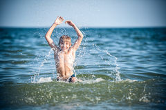 Little boy in the sea Royalty Free Stock Images
