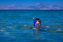 A little boy in a sea with a mask and snorkel Royalty Free Stock Images