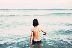 Little boy in sea Stock Photography