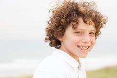 Little boy at sea shore Stock Photos