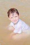 Little boy in the sea Stock Photos