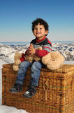 Little boy seated on a big basket Stock Photo
