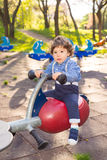 Little boy in seesaw Royalty Free Stock Photo