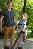 Little boy on seesaw Stock Photo