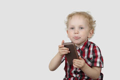 Little boy with sell phone Stock Image