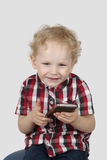 Little boy with sell phone Stock Images