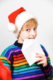 Little boy sending a letter to Santa Claus Stock Images