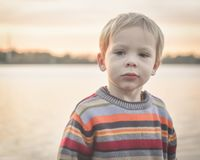 Little Boy Serious at Lake Royalty Free Stock Photo