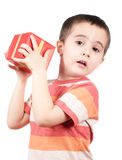 Little boy shakes gift box Royalty Free Stock Image