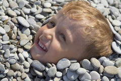 Little boy among shallow stone Royalty Free Stock Photos