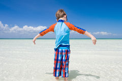 Little boy in shallow water Royalty Free Stock Image