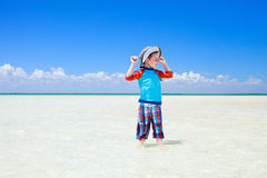 Little boy in shallow water Royalty Free Stock Images