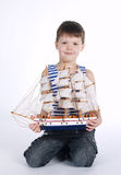 Little boy with ship on white Stock Photography