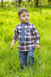 Little boy in shirt and jeans outdoors Royalty Free Stock Images