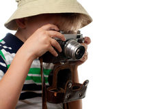 Little boy shooting on the vintage photo camera Stock Image