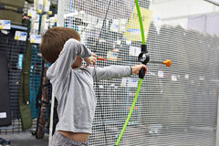 Little boy shoots by bow in children`s shooting range. Little boy shoots a bow in a children`s shooting range Stock Photo