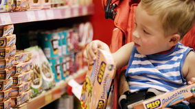 Little boy in the shop. stock footage