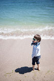 Little boy at the shore Stock Image