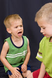 Little boy shouting at his brother. A cute little 3 year old boy shouting at his 5 year old brother Royalty Free Stock Image