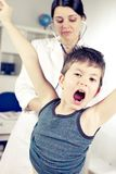 Little boy shouting during medical treatment funny Royalty Free Stock Photography